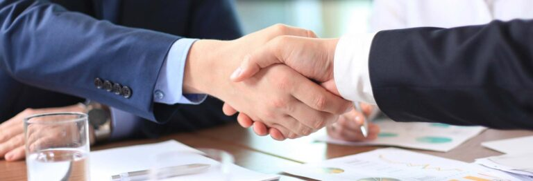 Shaking hands with commercial project client